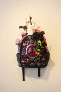"""Back Packin"" 16"" x 23"" found objects, toy guns, back pack"