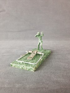 """Maverick"" 2"" x 3"" x 2"" mouse trap, plastic army men, glitter"